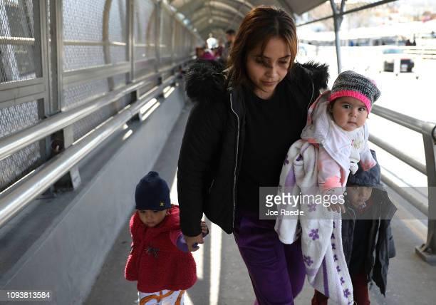 Daniela Serrano and her baby Maria de Jesus Cabrera from MichoacanMexico cross the Paso Del Norte Port of Entry bridge to turn themselves in to the...