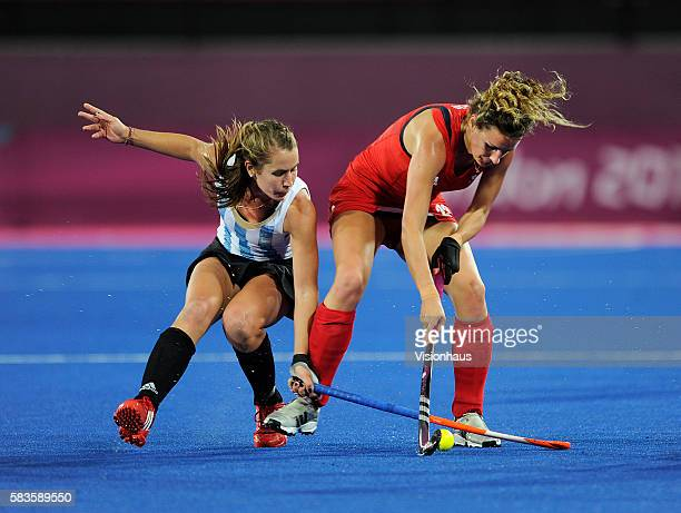 Daniela Sruoga of Argentina and Ashleigh Ball of Great Britain in action during the Womens Hockey semi final between Great Britain and Argentina as...