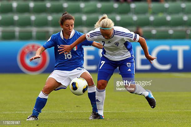 Daniela Stracchi of Italy battles for the ball with Annika Kukkonen of Finland during the UEFA Women's Euro 2013 group A match at Orjans Vall on July...