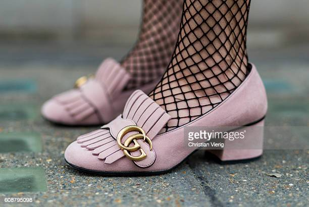 Daniela Suarez wearing net socks and Gucci loafers during London Fashion Week Spring/Summer collections 2017 on September 19 2016 in London United...