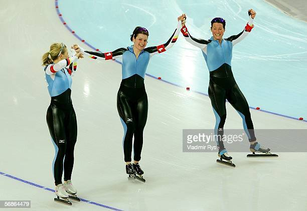 Daniela Thoms Anschuetz Anni Friesinger and Claudia Pechstein of Germany celebrate defeating Canada with a time of 30125 to win the gold medal in the...