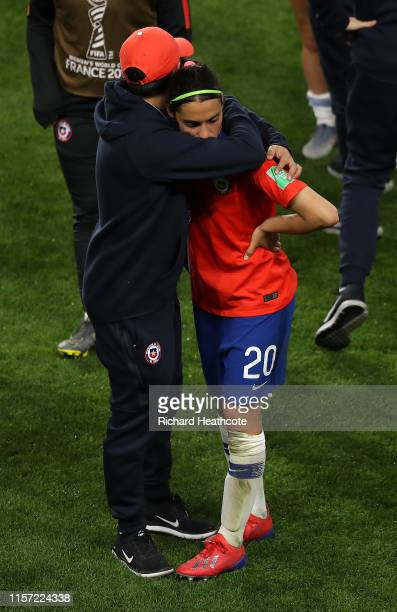 Daniela Zamora of Chile is consoled following the 2019 FIFA Women's World Cup France group F match between Thailand and Chile at Roazhon Park on June...