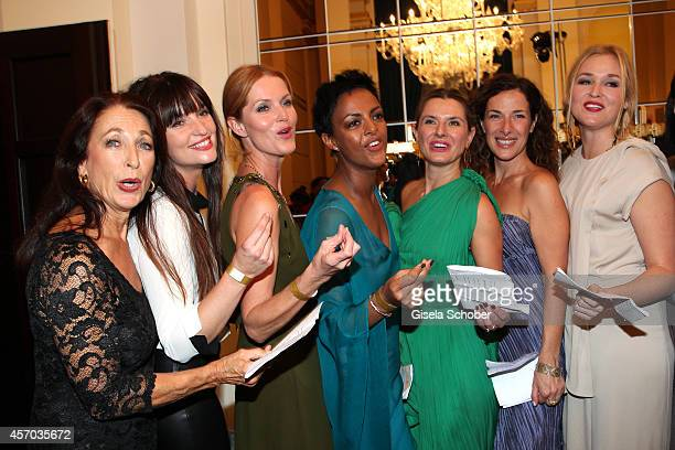 Daniela Ziegler, Ina Paule Klink, Esther Schweins, Dennenesch Zoude sings during the Hessian Film And Cinema Award 2014 on October 10, 2014 at Alte...