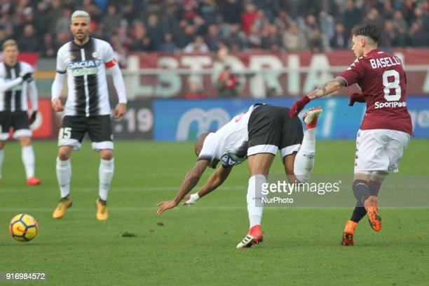 Daniele Baselli and Caetano De Souza Santos Samir compete for the ball during the Serie A football match between Torino FC and Udinese Calcio at...