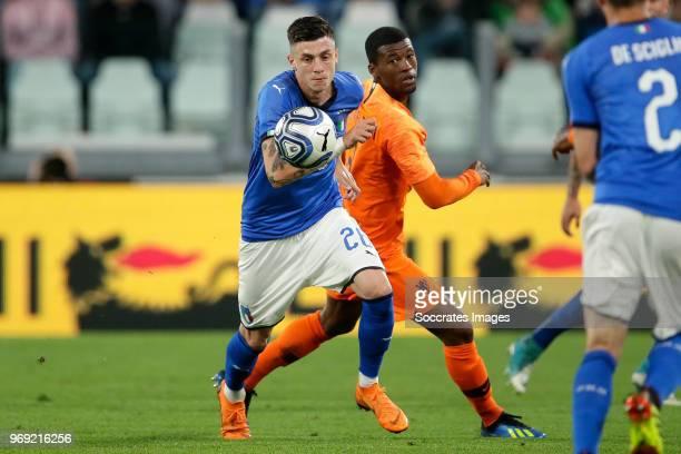 Daniele Baselli of Italy Georginio Wijnaldum of Holland during the International Friendly match between Italy v Holland at the Allianz Stadium on...
