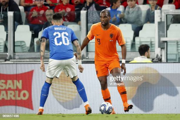 Daniele Baselli of Italy Ryan Babel of Holland during the International friendly match between Italy and The Netherlands at Allianz Stadium on June...