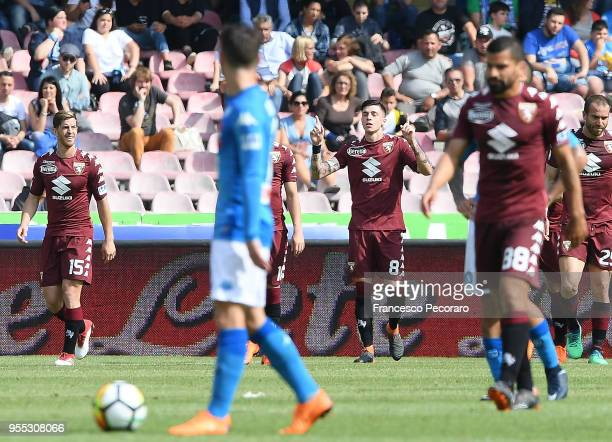 Daniele Baselli of Torino FC celebrates after scoring the 11 goal beside the disappointment of Dries Mertens of SSC Napoli during the serie A match...