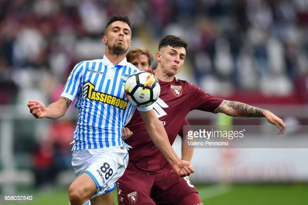 Daniele Baselli of Torino FC clashes with Alberto Grassi of Spal during the Serie A match between Torino FC and Spal at Stadio Olimpico di Torino on...