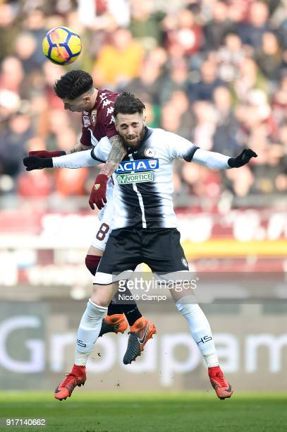 Daniele Baselli of Torino FC competes for a header with Francesco Zampano of Udinese Calcio during the Serie A football match between Torino FC and...