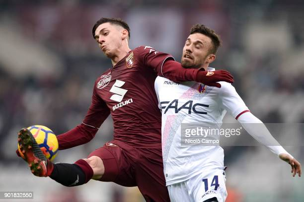 Daniele Baselli of Torino FC competes for the ball with Federico Di Francesco of Bologna FC during the Serie A football match between Torino FC and...