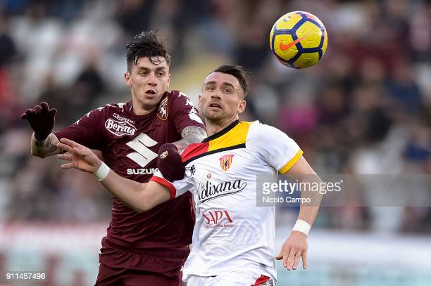 Daniele Baselli of Torino FC competes for the ball with Gaetano Letizia of Benevento Calcio during the Serie A football match between Torino FC and...