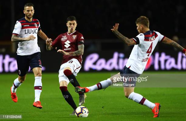 Daniele Baselli of Torino FC competes for the ball with Lyanco Evangelista of Bologna FC during the Serie A match between Torino FC and Bologna FC at...