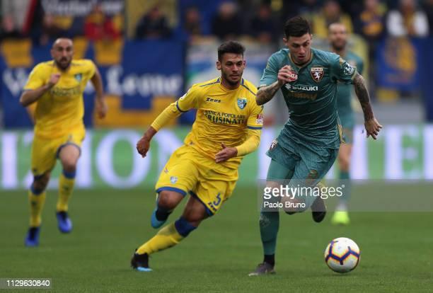 Daniele Baselli of Torino FC competes for the ball with Mirko Gori Frosinone Calcio during the Serie A match between Frosinone Calcio and Torino FC...