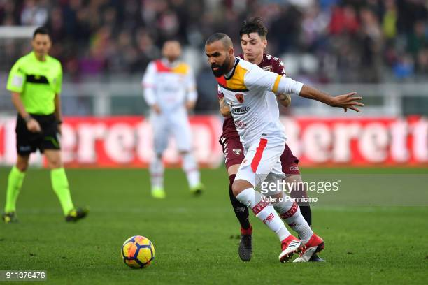 Daniele Baselli of Torino FC competes with Cordeiro Sandro Raniere of Benevento Calcio during the Serie A match between Torino FC and Benevento...