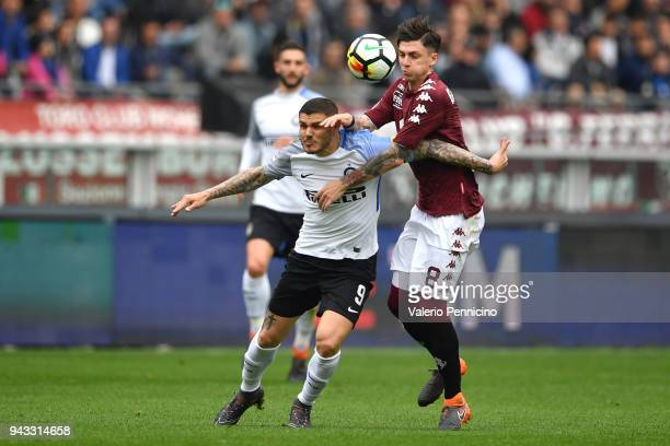 Daniele Baselli of Torino FC competes with Mauro Icardi of FC Internazionale during the Serie A match between Torino FC and FC Internazionale at...