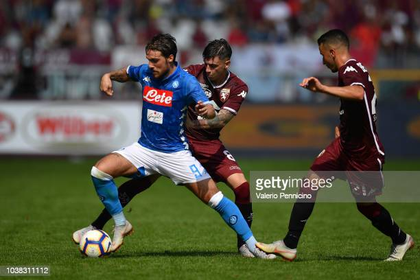 Daniele Baselli of Torino FC competes with Simone Verdi of SSC Napoli during the Serie A match between Torino FC and SSC Napoli at Stadio Olimpico di...