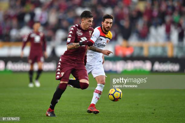 Daniele Baselli of Torino FC in action against Danilo Cataldi of Benevento Calcio during the Serie A match between Torino FC and Benevento Calcio at...