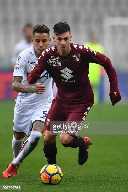 Daniele Baselli of Torino FC in action against ErickÊPulgar of Bologna FC during the serie A match between Torino FC and Bologna FC at Stadio...