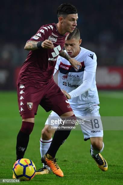 Daniele Baselli of Torino FC is challenged by Nicolo Barella of Cagliari Calcio during the Serie A match between Torino FC and Cagliari Calcio at...