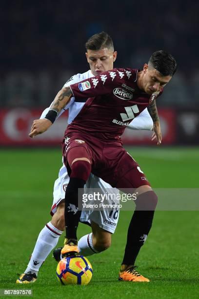 Daniele Baselli of Torino FC is challenged byb Nicolo Barella of Cagliari Calcio during the Serie A match between Torino FC and Cagliari Calcio at...
