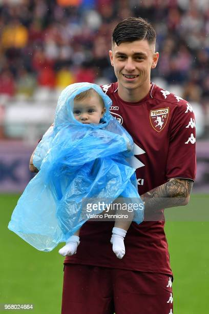 Daniele Baselli of Torino FC with his children during the Serie A match between Torino FC and Spal at Stadio Olimpico di Torino on May 13 2018 in...