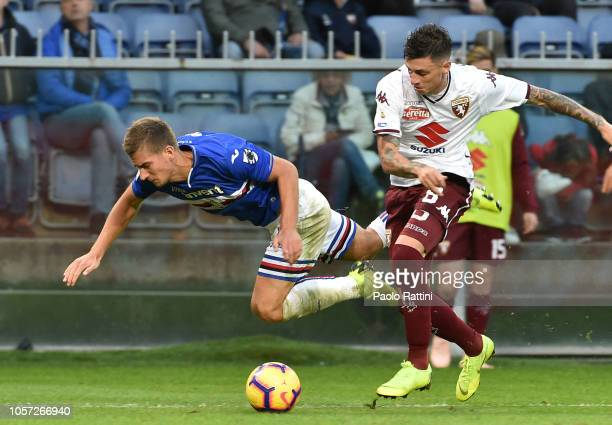 Daniele Baselli of Torino foul on Dennis Praet of Sampdoria for penalty during the Serie A match between UC Sampdoria and Torino FC at Stadio Luigi...