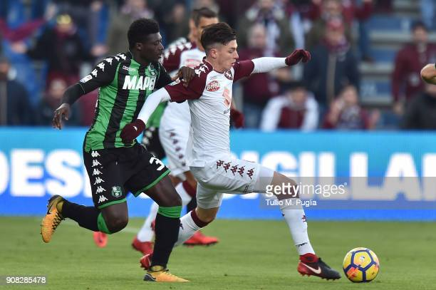 Daniele Baselli of Torino is challenged by Alfred Duncan of Sassuolo during the serie A match between US Sassuolo and Torino FC at Mapei Stadium...