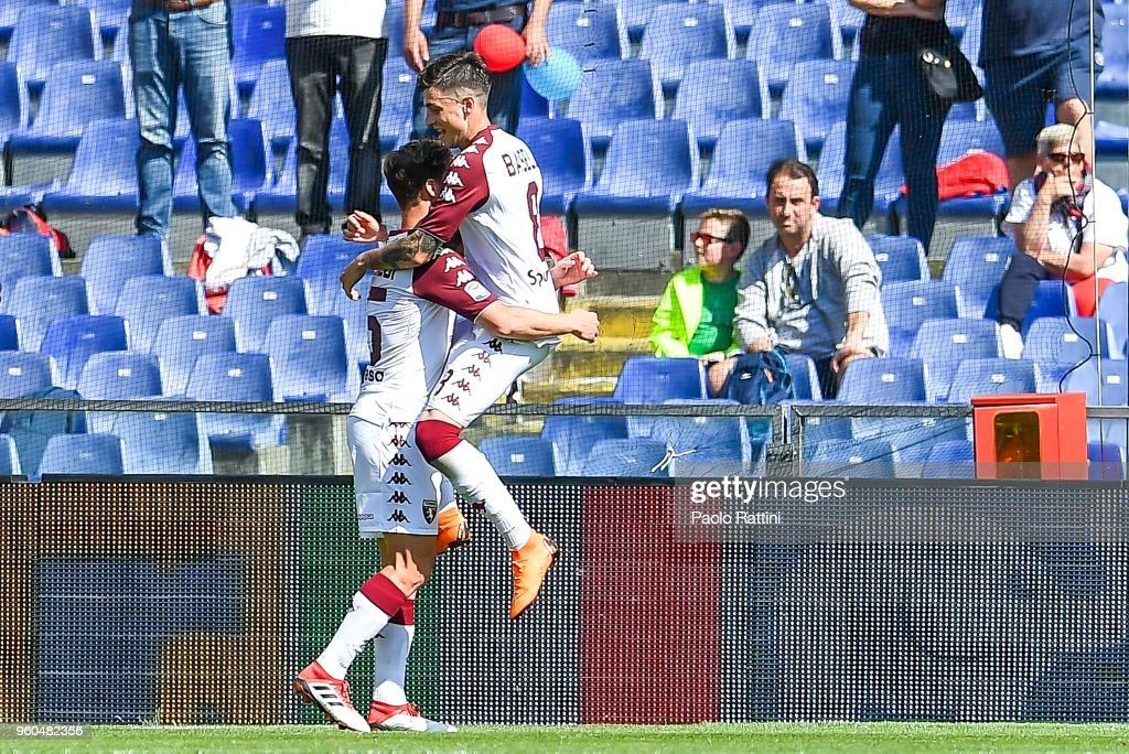 Daniele Baselli of Torino jumps over Cristian Ansaldi to celebrate his goal during the serie A match between Genoa CFC and Torino FC at Stadio Luigi Ferraris on May 20, 2018 in Genoa, Italy.