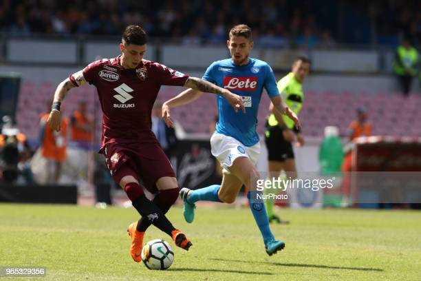 Daniele Baselli vies Jorginho during the Italian Serie A football SSC Napoli v Torino FC at S Paolo Stadium in Naples on May 6 2018
