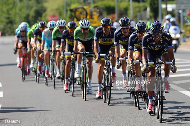 Daniele Bennati of Italy and Team Saxo-Tinkoff drives the pace at the head of the group during stage thirteen of the 2013 Tour de France, a 173KM...