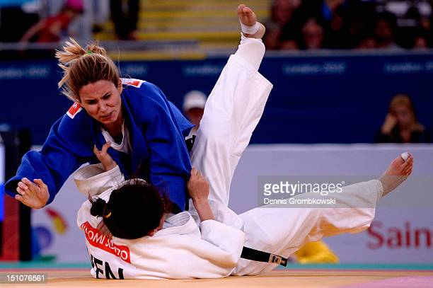 Daniele Bernardes Milan of Brazil and Naomi Soazo of Venezuela compete in the Women's 63kg Bronze Medal Contest on day 2 of the London 2012...