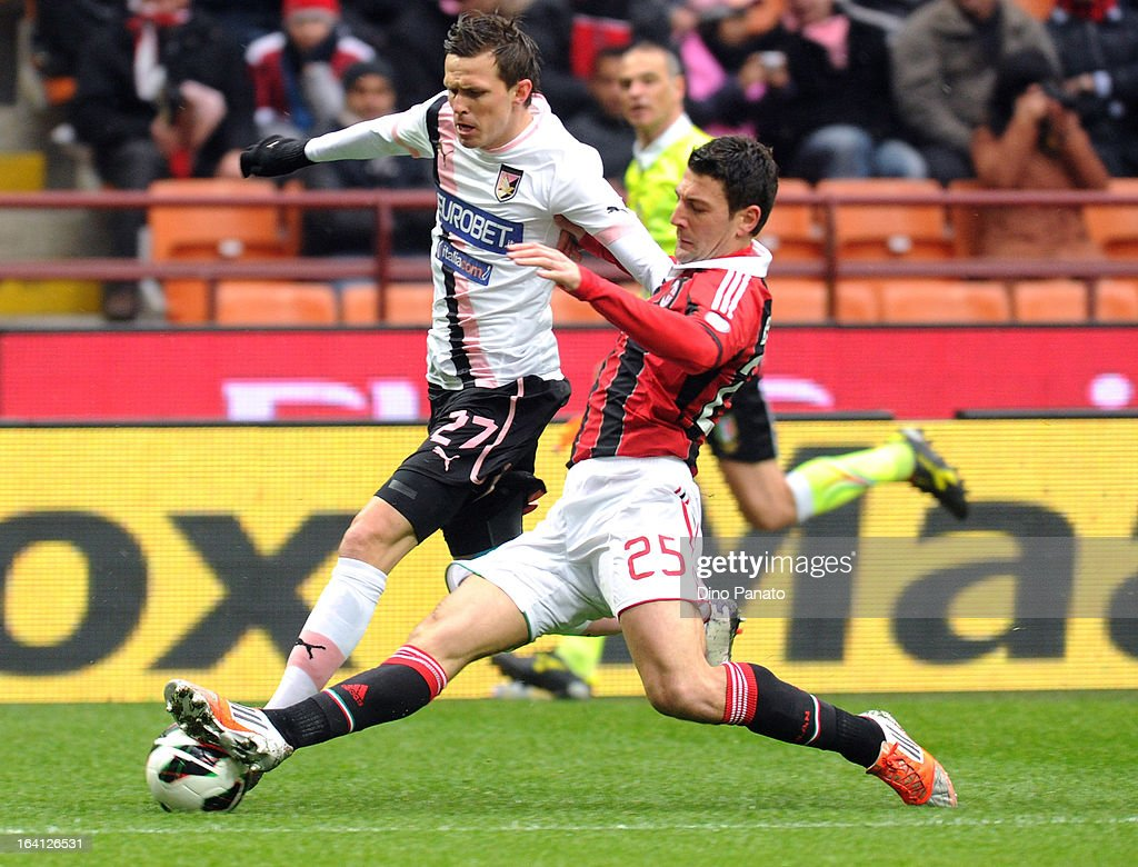 Daniele Bonera (R) of AC Milan competes with Josip Ilicic of US Citta di Palermo during the Serie A match between AC Milan and US Citta di Palermo at San Siro Stadium on March 17, 2013 in Milan, Italy.