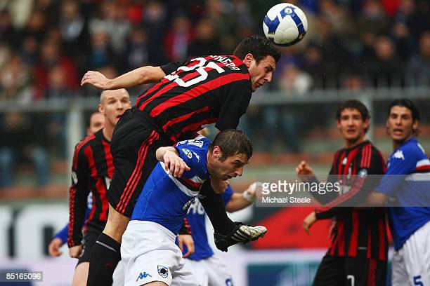 Daniele Bonera of Milan rises above the challenge of Stefano Lucchini during the Serie A match between Sampdoria and AC Milan at the Stadio Luigi...