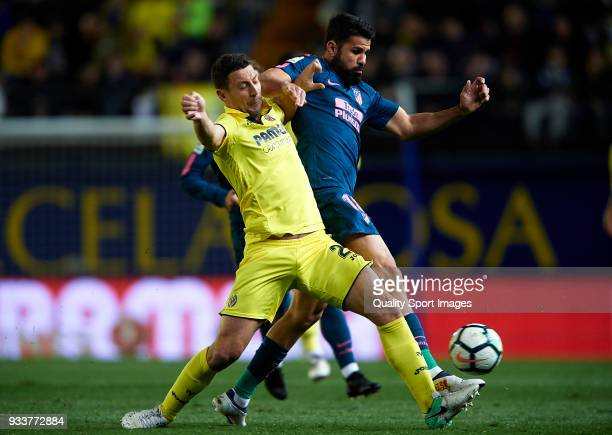 Daniele Bonera of Villarreal competes for the ball with Diego Costa of Atletico de Madrid during the La Liga match between Villarreal and Atletico...