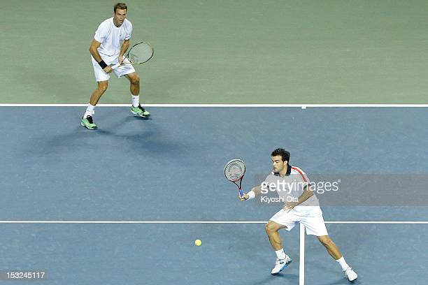 Daniele Bracciali of Italy and Frantisek Cermak of the Czech Republic play in their first round doubles match against Yuichi Sugita and Yasutaka...