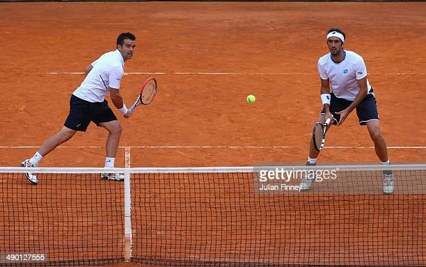 Daniele Bracciali of Italy and Potito Starace of Italy in action in the doubles against Max Mirnyi of Belarus and Mikhail Youzhny of Russia during...