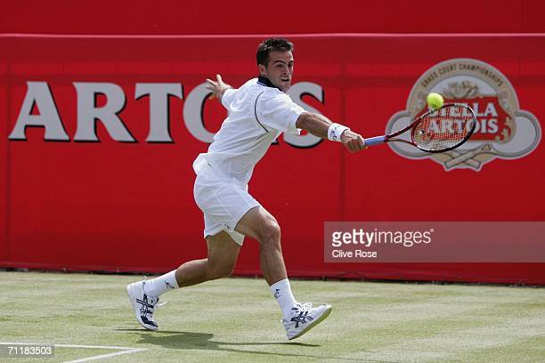 Daniele Bracciali of Italy in action during his first round match against Feliciano Lopez of Spain at the Stella Artois Championships at Queens Club...