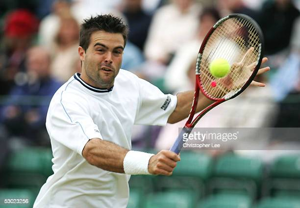Daniele Bracciali of Italy in action during the Mens Final against Ivo Karlovic of Croatia during the Surbiton Trophy at Surbiton racket and fitness...