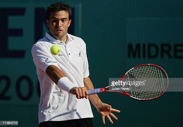 Daniele Bracciali of Italy plays a backhand in his match against Igor Sijsling of Netherlands during the Dutch Open Tennis on July 17 2006 in...