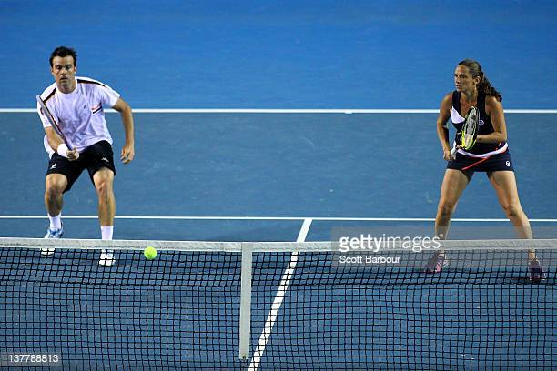 Daniele Bracciali of Italy plays a forehand in his semifinal mixed doubles match with Roberta Vinci of Italy against Leander Paes of India and Elena...