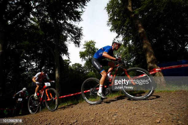 Daniele Braidot of Italy and Reto Indergand of Switzerland rides during the Men's Mountain Bike CrossCountry on Day Six of the European Championships...