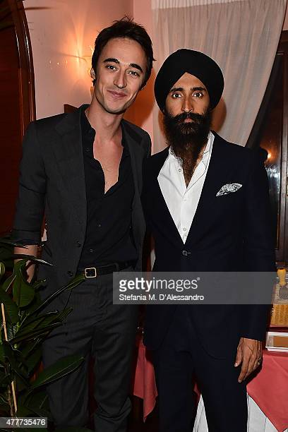 Daniele Cavalli and Waris Ahluwalia attend Ghurka cocktail party during 88 Pitti Immagine Uomo at Harry's Bar on June 18 2015 in Florence Italy