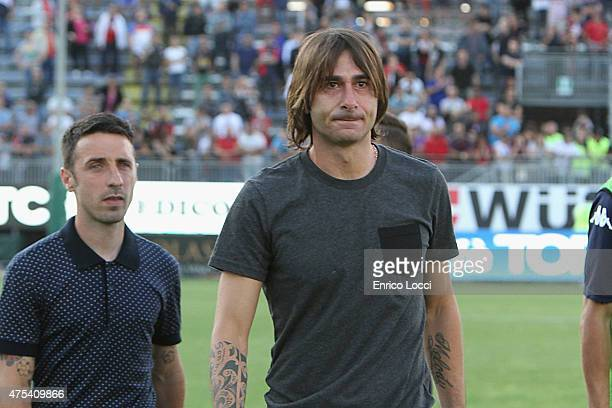 Daniele Conti and Andrea Cossu of Cagliari greets fans at the end of his career during the Serie A match between Cagliari Calcio and Udinese Calcio...