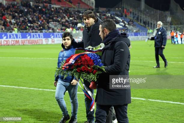Daniele Conti and Andrea Cossu pay homage in memory of Valery Melis during the Serie A match between Cagliari and Atalanta BC at Sardegna Arena on...