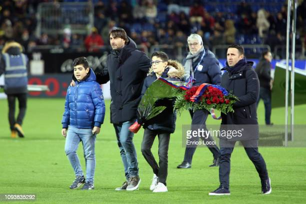 Daniele Conti and Andrea Cossu pay homage to the memory of Valery Melis ahead of the Serie A match between Cagliari and Atalanta BC at Sardegna Arena...