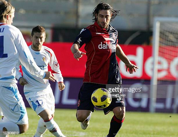 Daniele Conti of Cagliari in action during the Serie A match between Cagliari and Catania at Stadio Sant'Elia on December 12 2010 in Cagliari Italy