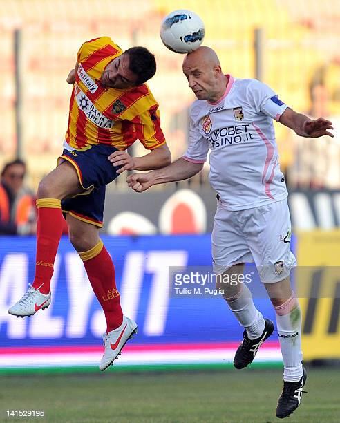 Daniele Corvia of Lecce and Giulio Migliaccio of Palermo compete for a header during the Serie A match between US Lecce and US Citta di Palermo at...