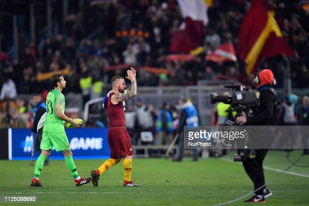 Daniele de Rossi and Antonio Mirante of AS Roma celebrates after the game during the UEFA Champions League Round of 16 First Leg match between AS...