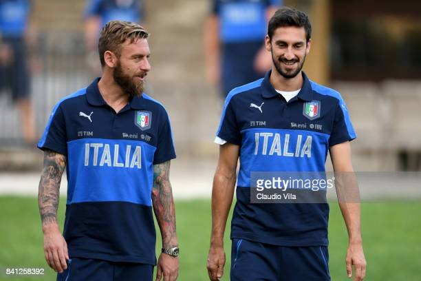 Daniele De Rossi and Davide Astori of Italy chat during the training session at Italy club's training ground at Coverciano on August 31 2017 in...