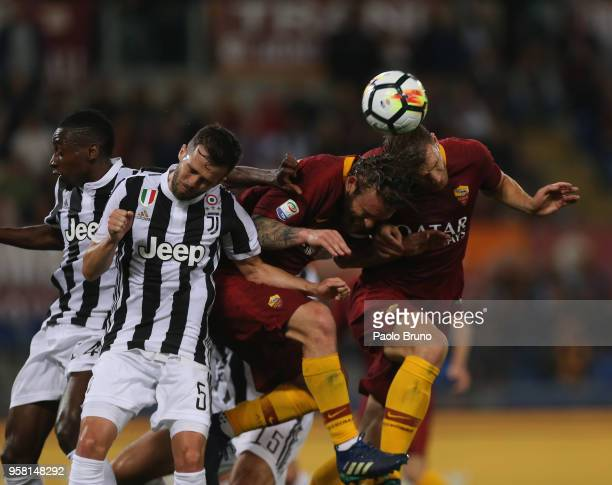 Daniele De Rossi and Edin Dzeko of AS Roma compete for the ball with Miralem Pjanic of Juventus during the Serie A match between AS Roma and Juventus...